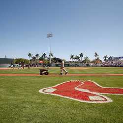 March 7, 2011; Fort Myers, FL, USA; Grounds keepers prepare the field for a spring training exhibition game between the Baltimore Orioles and the Boston Red Sox at City of Palms Park.   Mandatory Credit: Derick E. Hingle