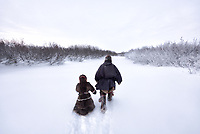 Lyonya and Yaqua, father and son, and Nenets Reindeer Herders to out to check rabbit snares.