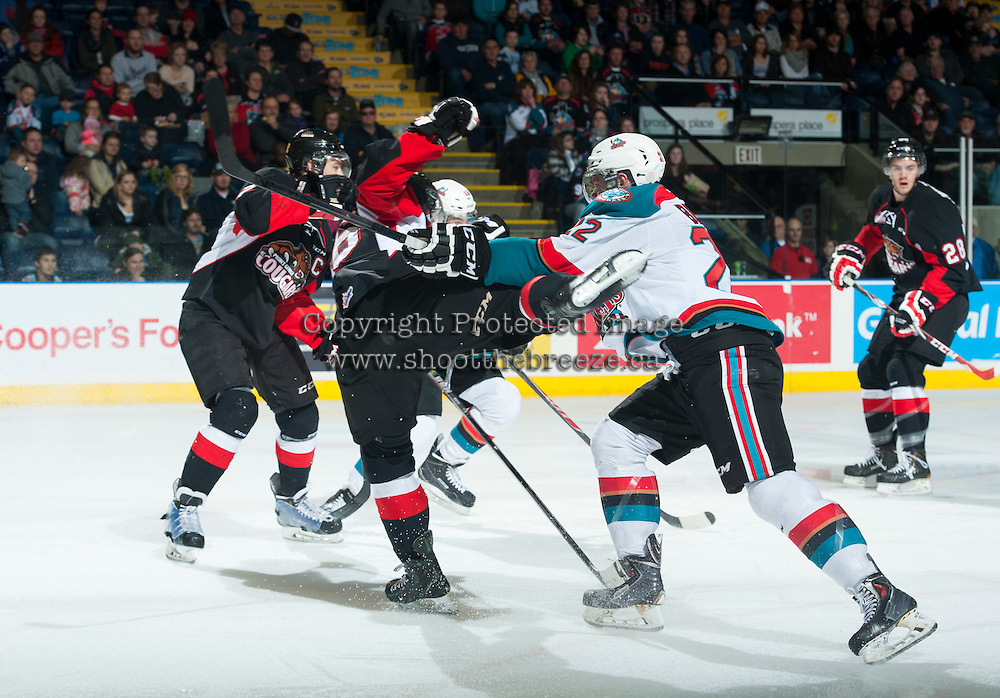 KELOWNA, CANADA - FEBRUARY 9: Chance Braid #22 of Kelowna Rockets checks former teammate Cal Babych #16 of Prince George Cougars to the ice during the second period on February 9, 2015 at Prospera Place in Kelowna, British Columbia, Canada.  (Photo by Marissa Baecker/Shoot the Breeze)  *** Local Caption *** Cal Babych; Chance Braid;