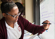 Students act out the drafting of the Constitution by the Continental Congress in Mariela Niland's U.S. History class at Young Women's College Preparatory Academy, November 8, 2013.