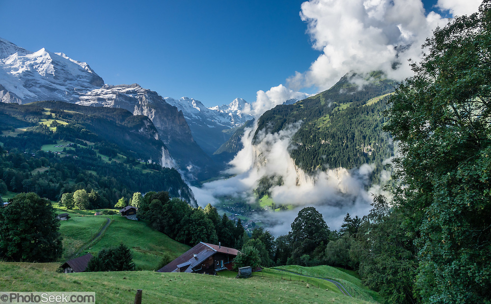 Lauterbrunnen village is in the canton of Bern, Switzerland, the Alps, Europe. This image was stitched from multiple overlapping photos.