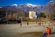 Children play games in a school playground in Bajram Curri with snow topped mountain in the Valbona Valley National Park behind on the 12th of December 2018, Albania. Bajram Curri is a town located in northern Albania, very close to the border with Kosovo, in a remote, mostly mountainous region. The town is named after Bajram Curri, a national hero who fought for ethnic Albanians, first against the Ottoman Empire and later against the Albanian government. (photo by Andrew Aitchison / In pictures via Getty Images)