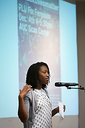 Princess Reece '14, recites a poem at a forum discussion of issues surrounding deaths of African-Americans by police and is sponsored by the Diversity Center, Women's Center and CCES held in the Scandinavian Center at PLU on Thursday, Dec. 4, 2014. (PLU Photo/John Froschauer)