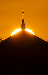 ©Licensed to London News Pictures 13/04/2020  <br /> Orpington, UK. An Easter Monday sunset tonight with the steeple and cross of St Barnabas church in Orpington, South East London. Photo credit:Grant Falvey/LNP
