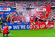 Charlton Athletic celebrate winning the play off trophy with champagne during the EFL Sky Bet League 1 play off final match between Charlton Athletic and Sunderland at Wembley Stadium, London, England on 26 May 2019.