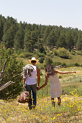 sexy cowboy and girl enjoying time together outdoors