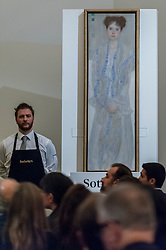 "© Licensed to London News Pictures. 24/06/2015. London, UK. A Sotheby's technician shows Gustav Klimt's ""Bildnis Gertrud Loew (Gertha Felsoványi)"", which was the star of tonight's evening sale as it sold for a hammer price of £22m, £4m more than its upper estimate of £12m-£18m. Sotheby's Impressionist & Modern art evening sale realised a total of £178.6m, the second highest total for any sale ever held in London. Photo credit : Stephen Chung/LNP"