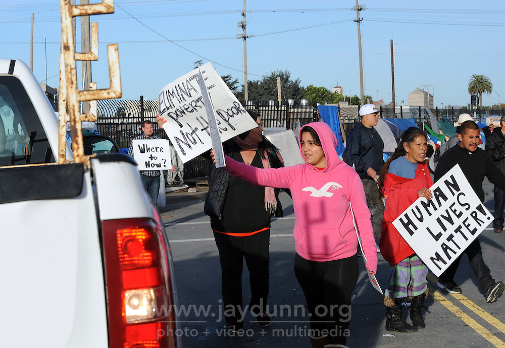 Protesters and Chinatown residents block Soledad Street from trucks commissioned by the city to clean up the area on Wednesday, March 23rd, 2016.
