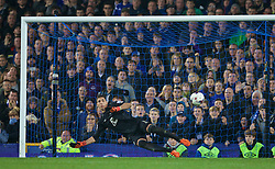 LIVERPOOL, ENGLAND - Tuesday, October 27, 2015: Everton's goalkeeper Joel Robles is beaten for the first penalty of the shoot-out against Norwich City by Graham Dorrans during the Football League Cup 4th Round match at Goodison Park. (Pic by David Rawcliffe/Propaganda)