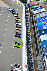 March 23, 2019 - Martinsville, VA, U.S. - MARTINSVILLE, VA - MARCH 23:   The trucks race single file during the 21st running of the NASCAR Gander Outdoors Truck Series TruNorth Global 250 race on March 23, 2019 at the Martinsville Speedway in Martinsville, VA.  (Photo by David John Griffin/Icon Sportswire) (Credit Image: © David J. Griffin/Icon SMI via ZUMA Press)