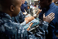 Emergency room physicians on board the USNS Comfort, a naval hospital ship, run a drill with fake patients to prepare for arrival in Haiti to help survivors of the earthquake on Tuesday, January 19, 2010 in the Caribbean Sea.