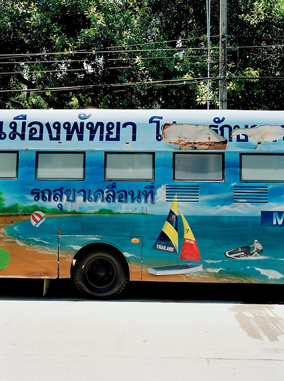 A bus used as a mobile bathroom painted with scenes of Pattaya beach.