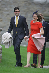 England cricket player Alastair Cook with his wife Alice, arrive at St Mary the Virgin, East Brent, Somerset, for the wedding of Ben Stokes and his fiancee Clare Ratcliffe.