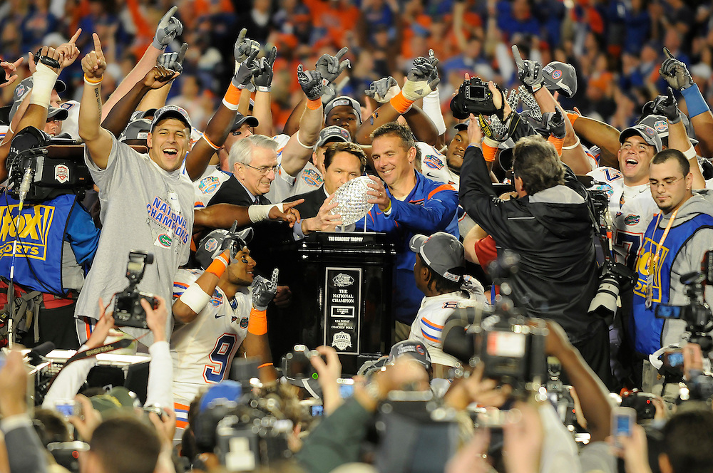 January 8, 2009: Head coach Urban Meyer of the Florida Gators accepts the national championship trophy after the NCAA football game between the Florida Gators and the Oklahoma Sooners in the 2009 BCS National Championship Game. The Gators defeated the Sooners 24-14.