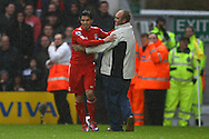 Picture by Paul Chesterton/Focus Images Ltd.  07904 640267.28/04/12.Luis Suárez of Liverpool scores his sides 3rd goal and celebrates as a happy Liverpool fan runs onto the pitch to join in during the Barclays Premier League match at Carrow Road Stadium, Norwich.
