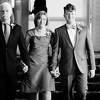 Matt's parents walk him down the aisle during his wedding ceremony at Germania Place in Chicago.