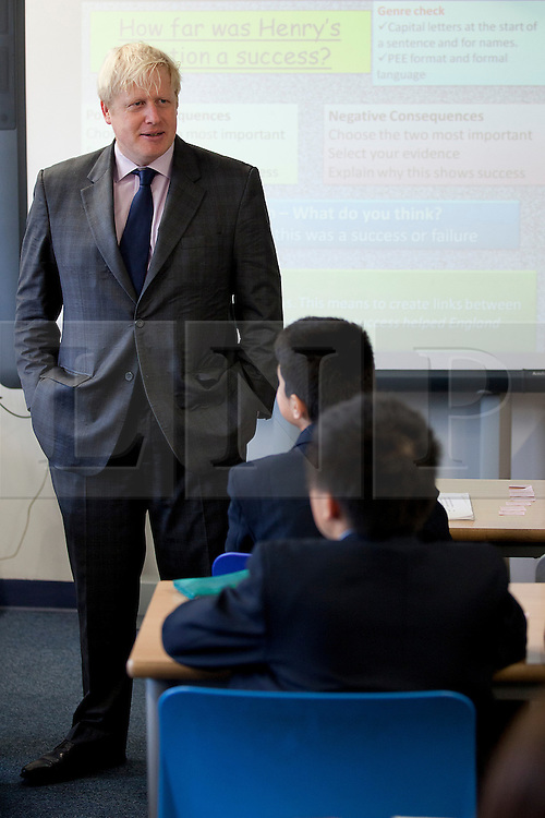 © Licensed to London News Pictures. 19/10/2012. LONDON, UK. Boris Johnson, the Mayor of London, takes party in a history lesson with school pupils of Pimlico Academy in London today (19/12/12) ahead of delivering a talk on making London a world leader in Education. Photo credit: Matt Cetti-Roberts/LNP