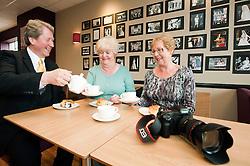 Dorothy Wright (right) and Beryl Wood (centre) with Royal Photographer Ian Pelham-Turner in the Debenhams restaurant Harrogate on Thursday evening..7 June 2012.Image © Paul David Drabble