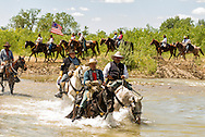Colenel George Custer, portrayed by Gary Stewart, officers of 7th Cavalry, lead troups across Little Bighorn River, Battle of the Little Bighorn Reenactment, Montana