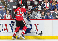 October 12, 2016: Ottawa Senators Right Wing Chris Neil (25) hits Toronto Maple Leafs Defenceman Matt Hunwick (2) against the boards during the NHL game between the Ottawa Senators and the Toronto Maple Leafs at Canadian Tires Centre in Ottawa, Ontario, Canada. (Photo by Steve Kingsman/Icon Sportswire)
