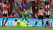 Brighton striker, Tomer Hemed (10) shot is saved during the Sky Bet Championship match between Brentford and Brighton and Hove Albion at Griffin Park, London, England on 26 December 2015.