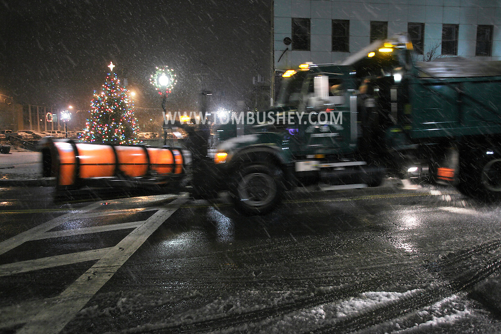 Middletown, NY - A snowplow drives down West Main Street during a storm on the night of Dec. 5, 2009.