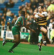 Zurich Premiership Rugby - London Irish v Wasps..Wasp's Kenny Logan, passes the ball over  London Irish's Paul Sackey . ...........   [Mandatory Credit, Peter Spurier/ Intersport Images].