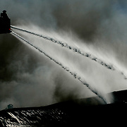 Weslaco, TX / 2006 - Firefighters use Ladder No. 1 to battle a warehouse blaze at the McManus Produce Company Jan. 17 on Business Route 83 in Weslaco, TX. - Photo by Mike Roy/The Monitor