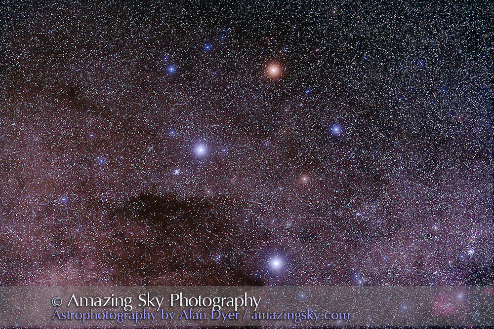 Southern Cross (Crux) taken with 135mm Canon L-series lens at f/4 with Hutech-modified Canon 5D camera at ISO 400 for stack of 8 x 4 minute exposures, with 2 exposures taken through haze, giving glows around stars. Taken at South Pacific Star Party, April 14, 2007.
