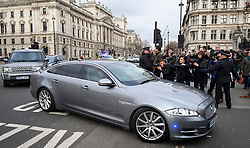 © Licensed to London News Pictures. 12/12/2018. London, UK. Media surround a car carrying British Prime Minster Theresa May as it arrives at the Houses of Parliament in Westminster, ahead of Prime Ministers Questions. The Prime Minister Theresa May faces a vote of no confidence from her own party. Photo credit: Ben Cawthra/LNP
