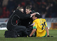 Doncaster - Friday January 30th 2009:Darel Russell is looked at by the trainer & doctor before being subsituted of Norwich City & \dr of Doncaster Rovers in action during the Coca Cola Championship Match at The Keepmoat Stadium Doncaster. (Pic by Steven Price/Focus Images)