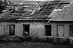 One of the old devastated building of the house for the released an old prisoners in village Blagoveshenka, Kemerovo region, Eastern Siberia, Russia, 15 August 1995. Blagoveshensky house for an old former prisoners a special institution which is a part of a penitentiary system where live former prisoners which after released have age more then 55 years and haven't house or an apartment and relatives.