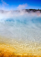 The colors at Sunset Lake in Yellowstone National Park are caused by a combination of algae, mineral deposits, cyanobacteria and acidic water.
