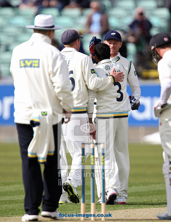 Picture by Paul Gaythorpe/Focus Images Ltd +447771 871632.24/04/2013.Yorkshire County Cricket Club players congratulate bowler Adil Rashid on taking the wicket of Callum Thorpe during the LV County Championship Div One match at Emirates Durham ICG, Chester-le-Street.
