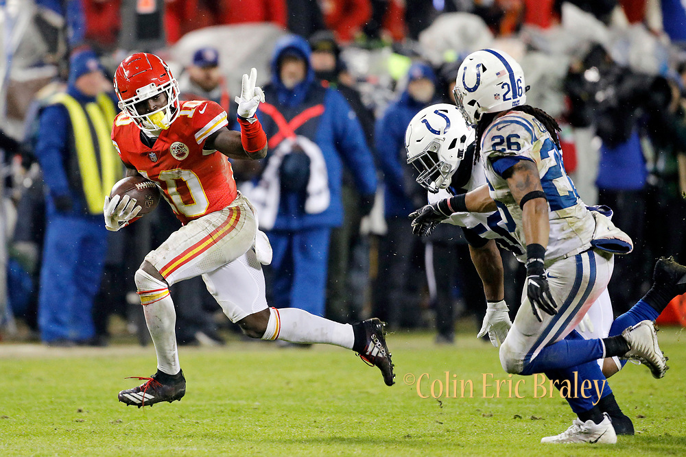 Kansas City Chiefs wide receiver Tyreek Hill (10) gives Indianapolis Colts linebacker Anthony Walker (50) and safety Clayton Geathers (26) the peace sign as he rushes for a first down during an NFL AFC Divisional football game at Arrowhead Stadium in Kansas City, Mo., Saturday, Jan. 12, 2019.  (AP Photo/Colin E. Braley)