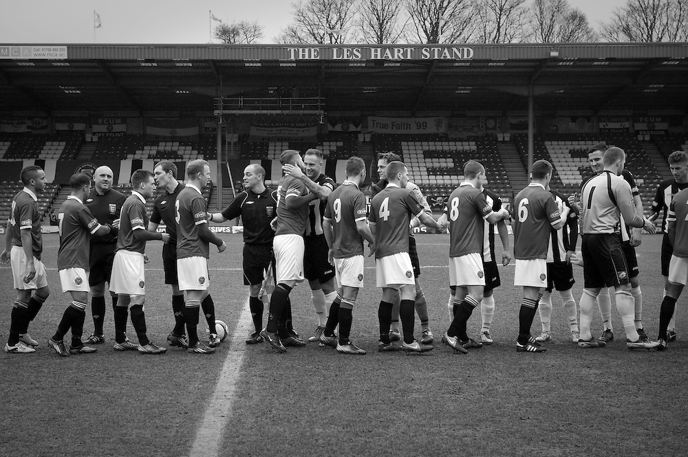 FC United of Manchester play a local team Chorley at Bury football club's ground in Lancashire, Britain. Photo shows FC United of Manchester players shake hands with their opponents before the match.