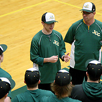 Head JCC Baseball coach Matt Cumming along with father and assistant coach Mike Cummings go over instructions with team at JCC wednesday afternoon 3-2-16 photo by Mark L. Anderson
