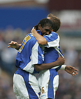 Photo: Lee Earle.<br /> Portsmouth v Reading. The Barclays Premiership. 28/10/2006. Portsmouth's Gary O'Neil (R) congratulates Kanu after he scored their second.