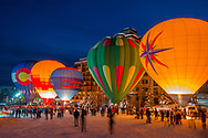 Hot air balloons are inflated at dusk at the base of the Steamboat Resort ski area, Steamboat Springs, Colorado.