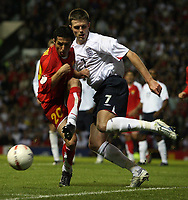 Photo: Paul Thomas.<br /> England v Macedonia. UEFA European Championships 2008 Qualifying. 07/10/2006.<br /> <br /> Aco Stojkov (L) of Macedonia wins the ball from Michael Carrick.
