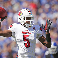 U of L quarterback Teddy Bridgewater throws to one of his receivers in the first quarter as the University of Kentucky plays the University of Louisville at Commonwealth Stadium in Lexington, Ky. Saturday Sept. 14, 2013. Photo by David Stephenson