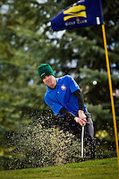 Andrew Roller from Coeur d'Alene High blasts a shot out of the sand trap on hole 3 at Prairie Falls Golf Club in Post Falls during the Post Falls Invitational Thursday.