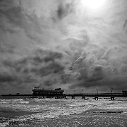 NORFOLK, VA - JULY 4: The sun attempts to peek out from the clouds over the Ocean View Fishing Pier as Hurricane Arthur leaves Hampton Roads on Friday, July 4th, 2014 in Norfolk, Va.