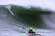 Brock Little descends into a monster wave during Heat 1 at the 2008 Mavericks Surf Contest on January 12, 2008 in Half Moon Bay.