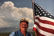 "Mario Potenzieri, a survivor of the terrorist attacks on the Twin Towers at the World Trade Center in New York on September11, 2001, flies the American flag at his home in Green Valley, Arizona, USA.  Potenzieri refers to the view of two mountains, Mount Hopkins and Mount Wrightson, from his home as ""my therapy room.""  He suffered from post traumatic stress disorder after his ordeal."