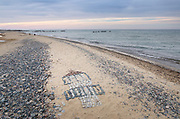Artwork in sand made of stones Whitefish Point beach Michigan