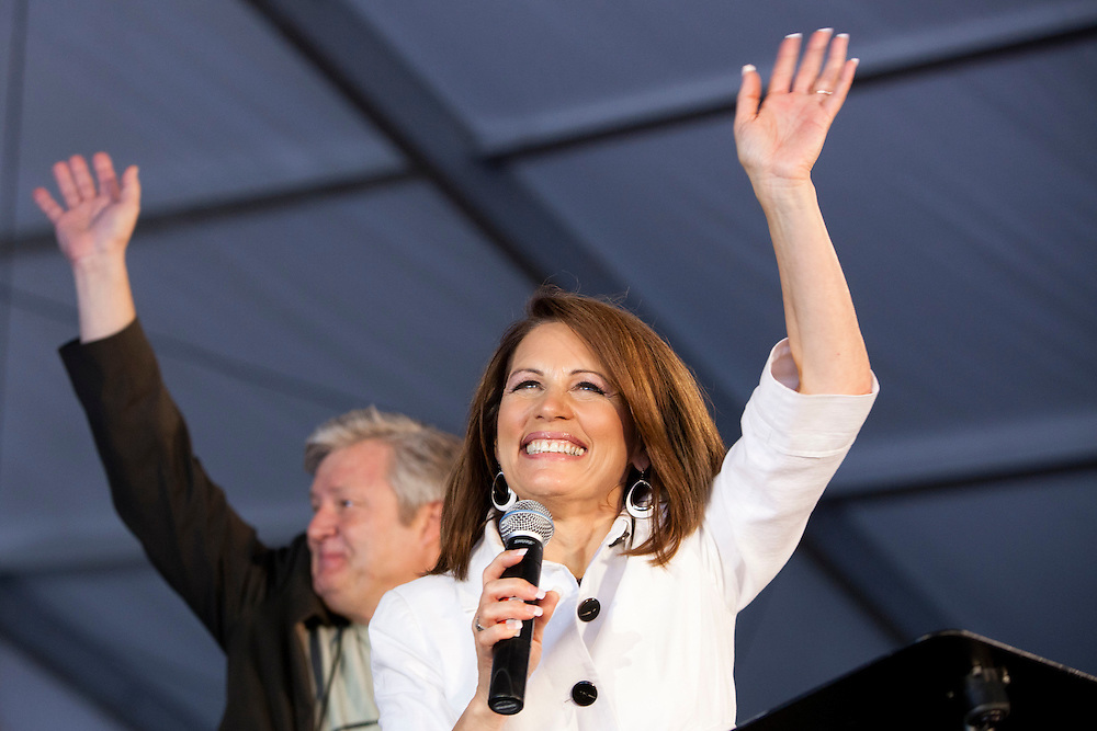 Republican presidential hopeful Michele Bachmann and her husband Marcus Bachmann wave from the stage in her tent at the Iowa Republican Straw Poll on Saturday, August 13, 2011 in Ames, IA.