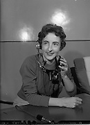 15/12/1959<br /> 12/15/1959<br /> 15 December 1959<br /> <br /> Miss Eileen Rice is one of the Many Willing Workers who stayed on Christmas day to connect greeting calls at the P.O. Exchange in Dublin