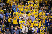 Golden State Warriors fans watch as the Golden State Warriors take on the Houston Rockets during Game 6 of the Western Conference Finals at Oracle Arena in Oakland, Calif., on May 26, 2018. (Stan Olszewski/Special to S.F. Examiner)
