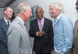 The Prince of Wales (second left) talks to Sir Richard Branson (right) who lost his home in Hurricane Irma, as he attends a community reception at Government House in The British Virgin Islands, as he continues his tour of hurricane-ravaged Caribbean islands.